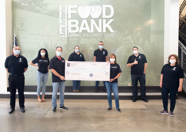 Representatives of Wyatt Law Firm present a $100,000.00 check to the San Antonio Food Bank on May 4, 2020.