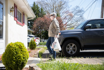 Volunteer delivers meals to a homebound senior in Mercer County, New Jersey
