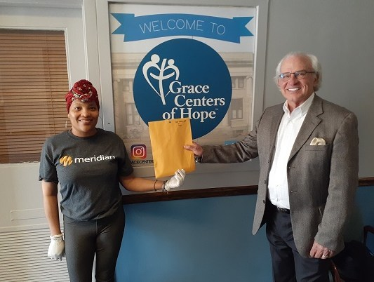 A Meridian volunteer delivers Walmart gift cards to Grace Centers of Hope to help those in need access essential healthcare and educational supplies during the COVID-19 crisis.