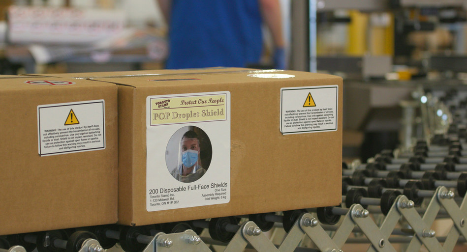 Face shields coming off of Toronto Stamp conveyor belt and headed to Ottawa (CNW Group/Toronto Stamp Inc.)