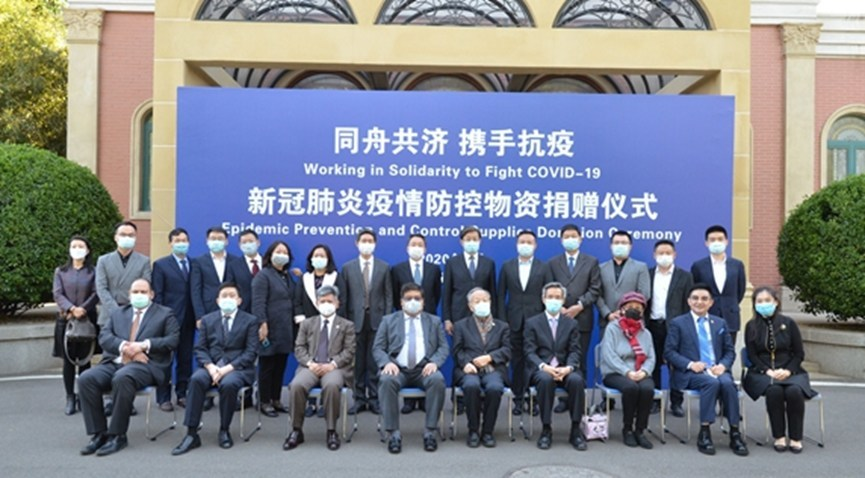 Group photo of leaders and guests participating in donation