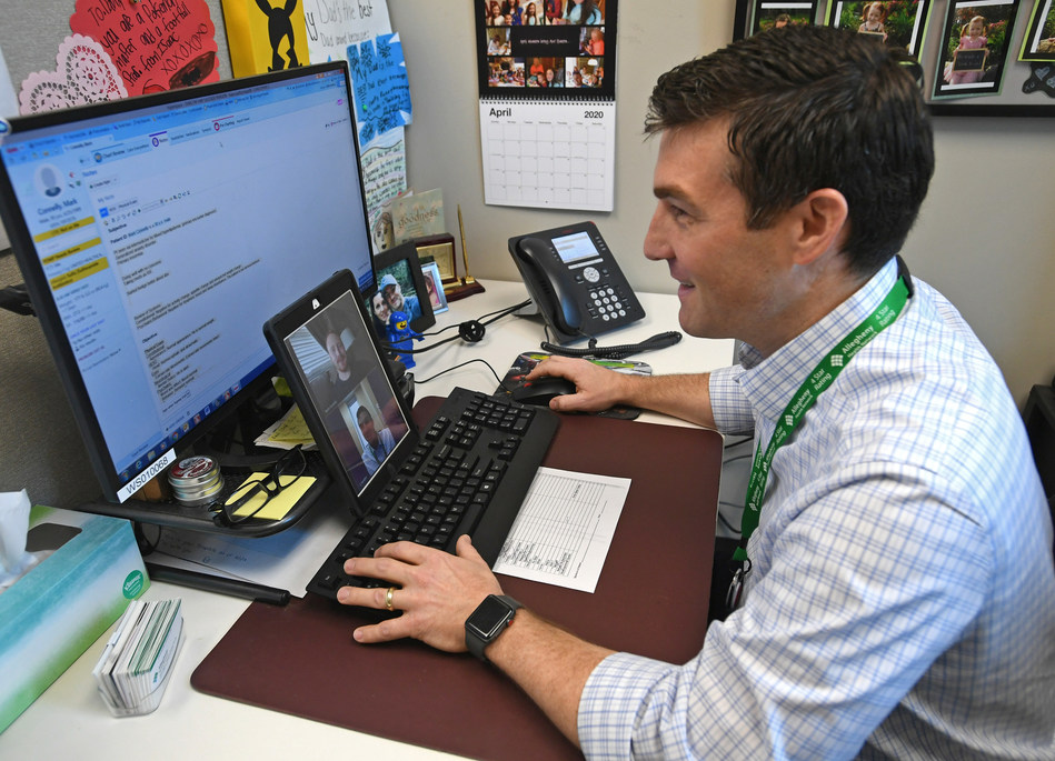 Dr. Chris Serafini from Allegheny Health Network conducts a telehealth visit. / Photo credit: Christopher Millette, Erie Times-News
