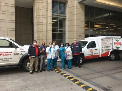 Dave Komosa of Suburban Propane and Joe Aurelio of Aurelio's Pizza delivering 1,000 meals to hospital staff.