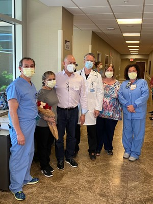 Zoila and Diego Laserna stand with members of the team that cared for Zoila for more than seven weeks at Baptist Health Lexington. Team members are left to right: Intensivist Dr. Yuri Villaran; hospital epidemiologist Dr. Mark Dougherty; and nurse leaders Carole Bales, RN, MBA, and Donita Cantrell, RN, MSN.