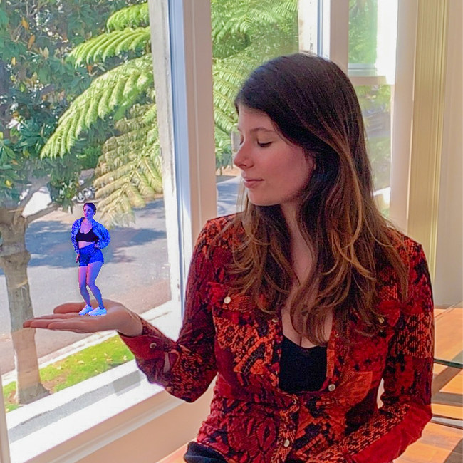 Project Producer, Carolina Rizzotto, holding Laura's hologram in the palm of her hand.