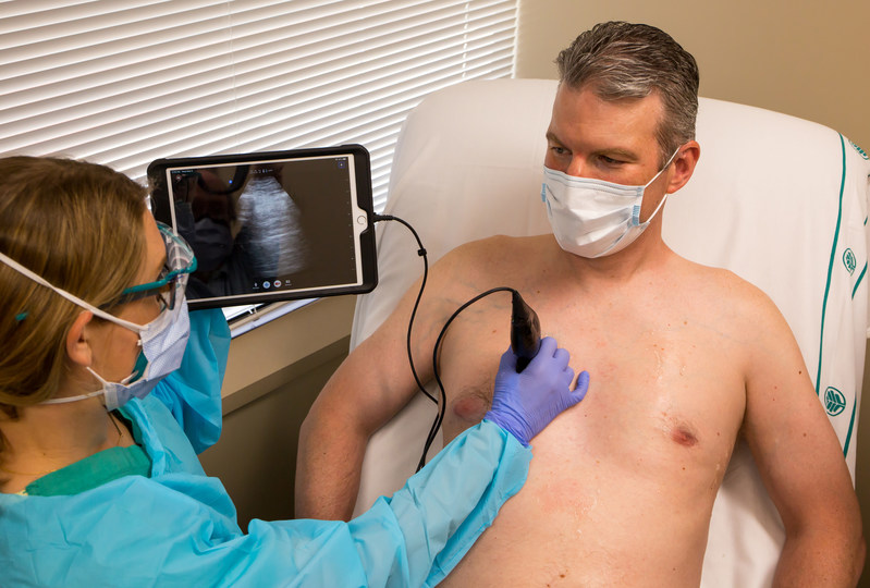 Atrium Health is the first major health system in the nation to put into wide practice the Butterfly iQ, a new, portable, point-of-care ultrasound device. It features a hand-held probe that connects to a smartphone or tablet, allowing a physician to quickly and safely examine various areas of a patient's body. Photo Credit:  Kevin M. McCarthy/Atrium Health