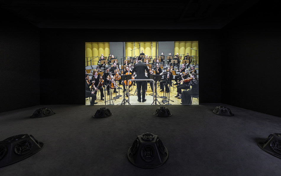 Muted Situations #22: Muted Tchaikovsky's 5th, 2018, HD video, eight-channel sound installation, and carpet, 45 min, Courtesy of the artist Installation view, 2019. Image: Winnie Yeung @ iMAGE28 Courtesy of M+, Hong Kong
