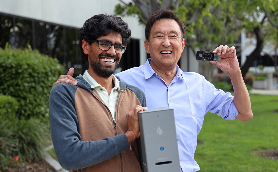 Fluxergy's Co-Founder & President Tej Patel (left) and Investor & Co-Founder of Kingston Technologies, John Tu (right) with the Fluxergy Analyzer and Test Card.