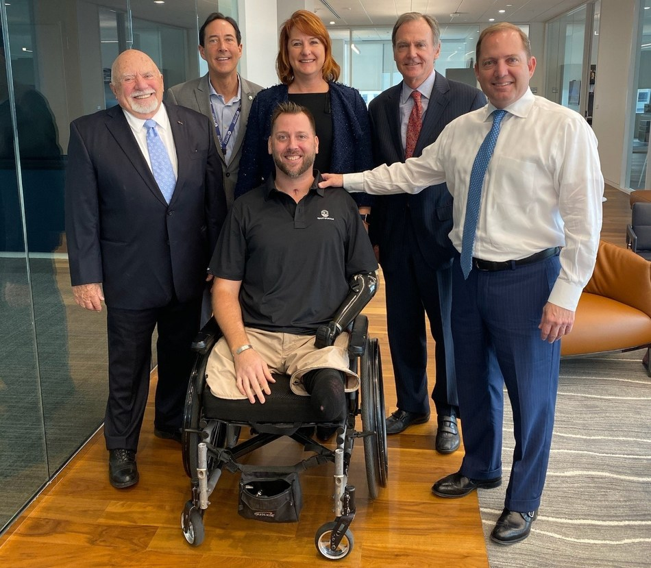 QL+ and PenFed at PenFed Headquarters in Tysons, Va. Left to right front: Jon Monett, QL+ Founder and President; Adam Keys, QL+ beneficiary; James Schenck, PenFed President and CEO. Left to right back: Steve Bosack, PenFed Special Advisor to the President and Chief Communications Officer; Catherine Harkins, QL+ Director of Finance and Administration; and Charlie Kolb, QL+ Executive Director.