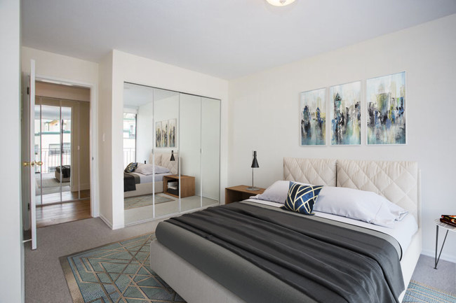 This bedroom in a Vancouver condo was virtually staged by Bella Staging. The attention to detail, including reflections and shadows, makes the rooms look realistic and leads clients to realize the possibilities.