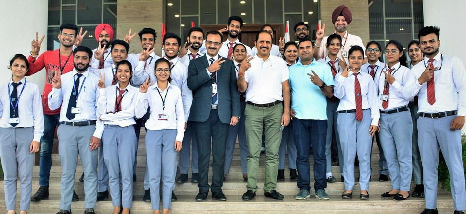 Selected MBA students of Chandigarh University in joyous mood with Flipkart Company Officials after Campus Placement
