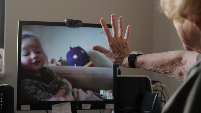 """""""Marion skypes with granddaughter on iPad"""" Photo Courtesy of Cyber-Seniors"""