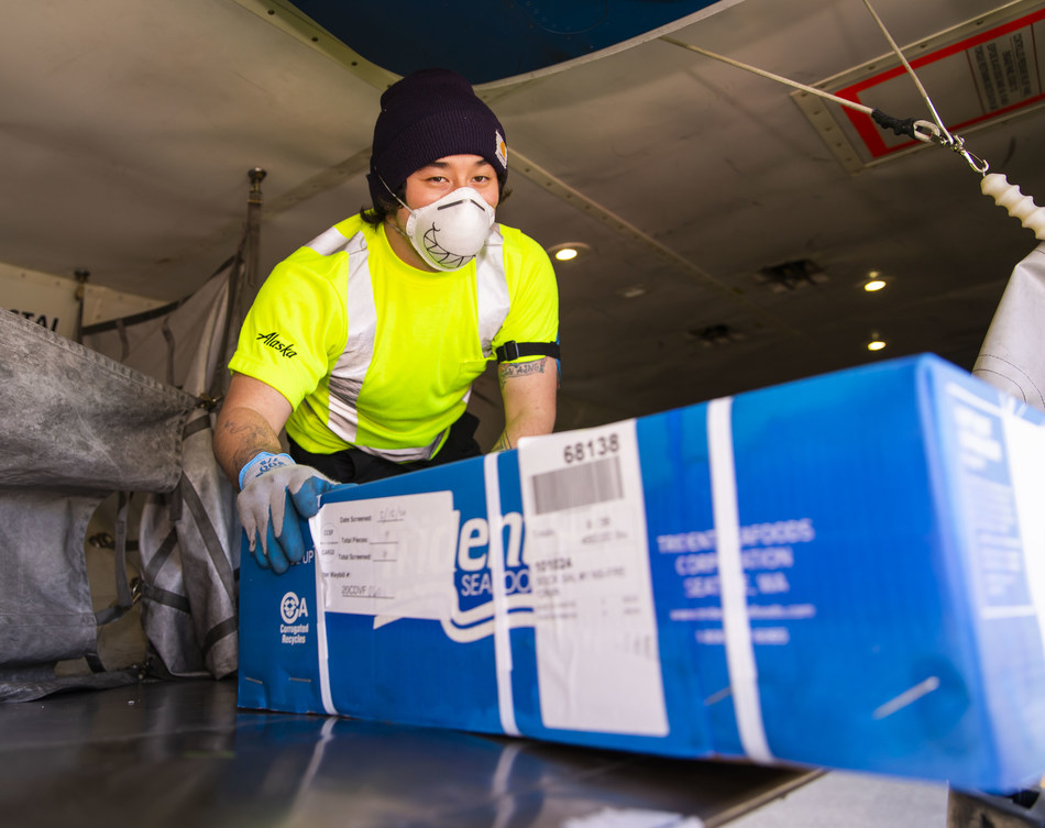 Alaska Air Cargo employees unload the season's first Copper River salmon from Cordova, Alaska.