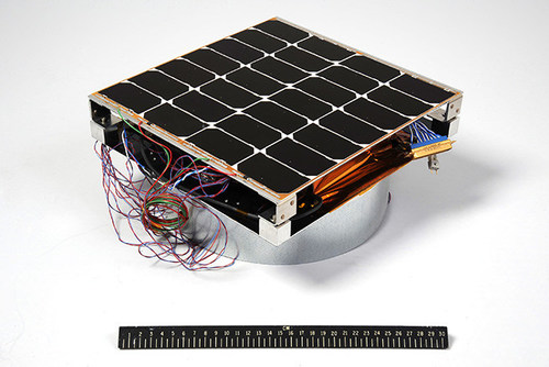 Image of the Photovoltaic Radio-frequency Antenna Module (PRAM) with a 12-inch ruler for scale. The hardware is the first orbital experiment designed to convert sunlight for microwave power transmission for solar power satellites. (Image Courtesy of U.S. Naval Research Laboratory)