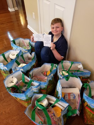 Giant Charlie Lettice of Manalapan, NJ is putting together care packages full of essential items, such as paper towels and food items, for families in need in his community.