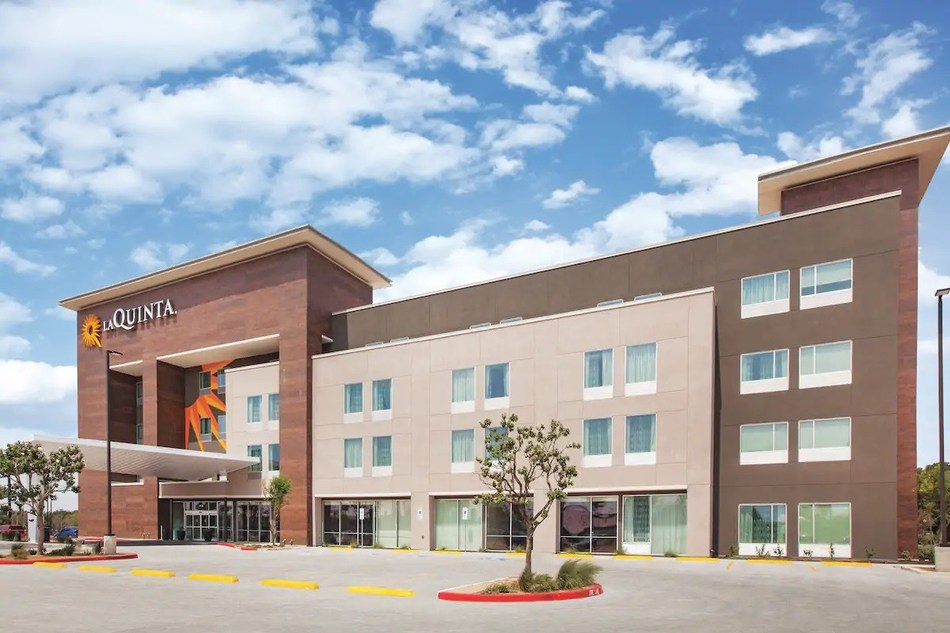 Above, the 104-room La Quinta Inn & Suites by Wyndham Wisconsin Dells is one of nearly a dozen recent new-construction openings in drive-to destinations for Wyndham Hotels & Resorts