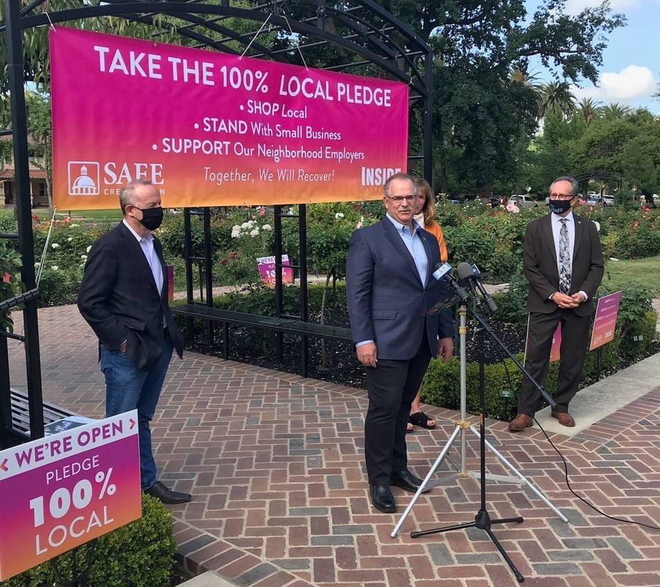 From left, Sacramento Mayor Darrell Steinberg, SAFE Credit Union President and CEO Dave Roughton, and Sacramento Vice-Mayor Jeff Harris discuss the 100% Local Pledge initiative Tuesday, May 19, 2020, in Sacramento, California.