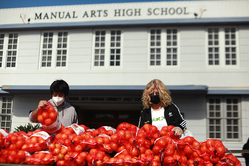 Founder and CEO of CAULIPOWER Gail Becker provides food relief assistance at Manual Arts High School in Los Angeles, CA in collaboration with the American Heart Association