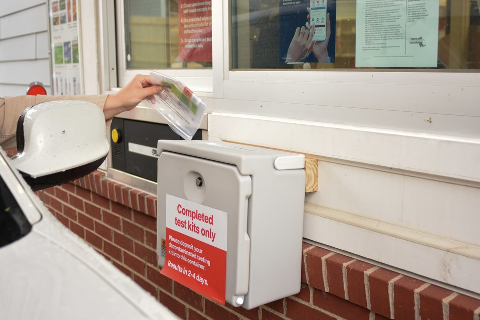 A patient completes a self-swab COVID-19 test at a CVS Pharmacy drive-thru testing site, one of a thousand locations the company plans to operate around the country by the end of May.  Photo Courtesy CVS Health