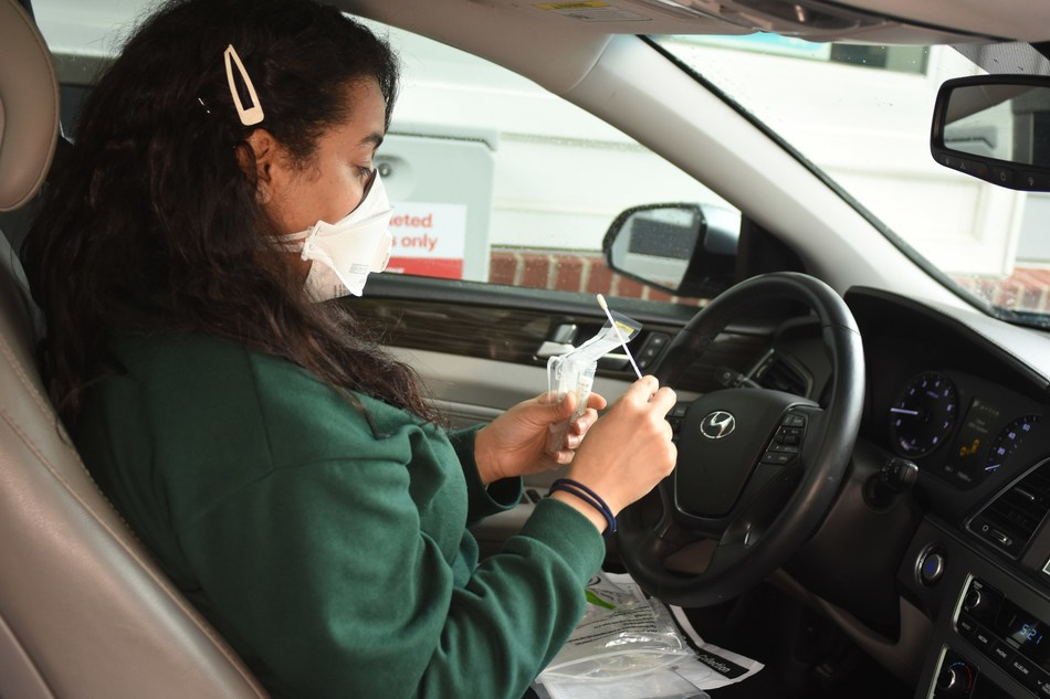 A patient administers a self-swab COVID-19 test at a CVS Pharmacy drive-thru testing site, one of a thousand locations the company plans to operate around the country by the end of May. Photo Courtesy CVS Health