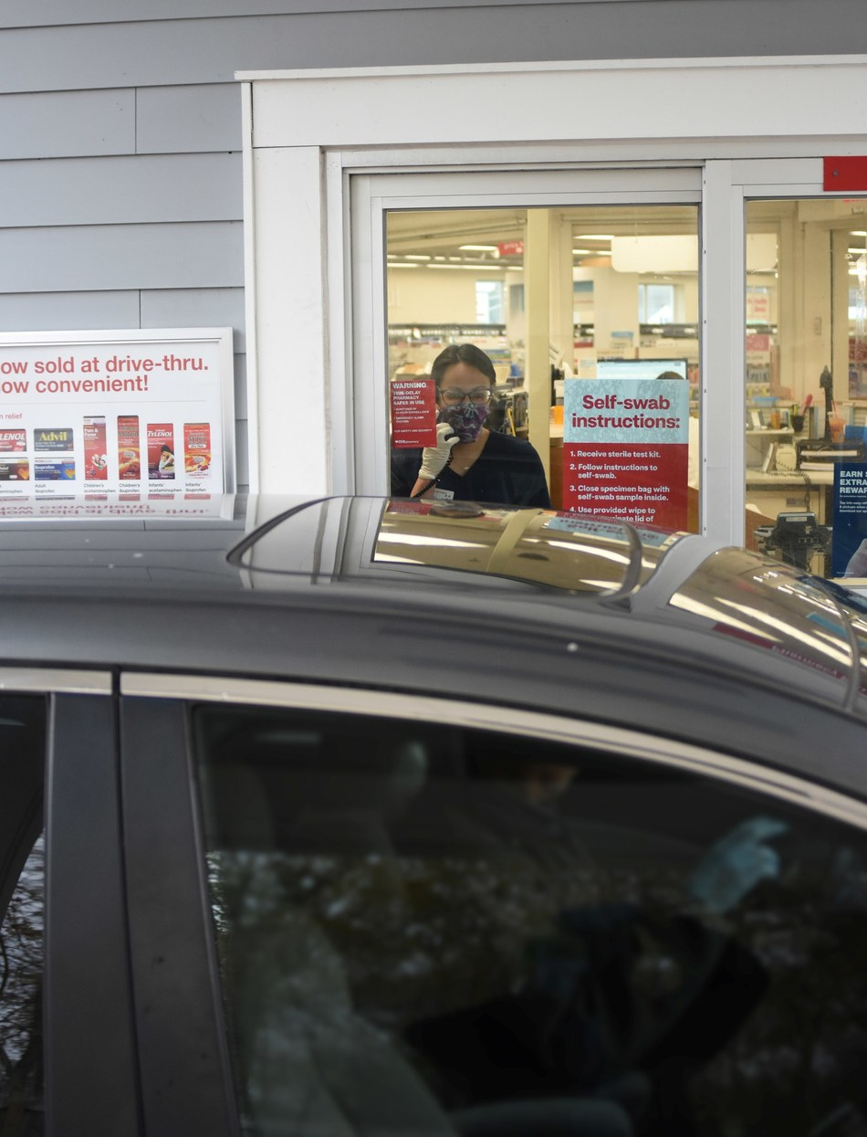 A CVS Pharmacy technician observes a patient administer a self-swab COVID-19 test at one of the company's drive-thru testing locations throughout the country. Photo Courtesy CVS Health
