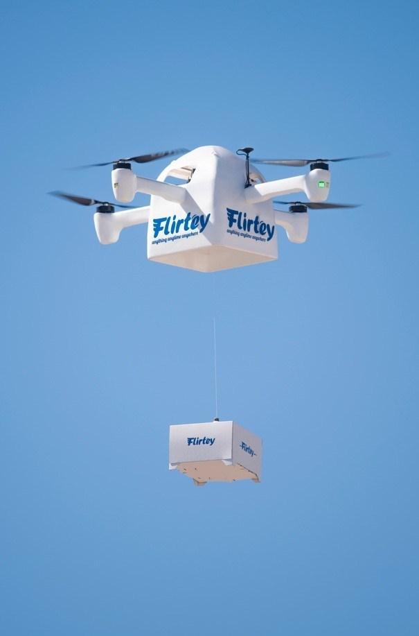 The Flirtey Eagle delivering a package