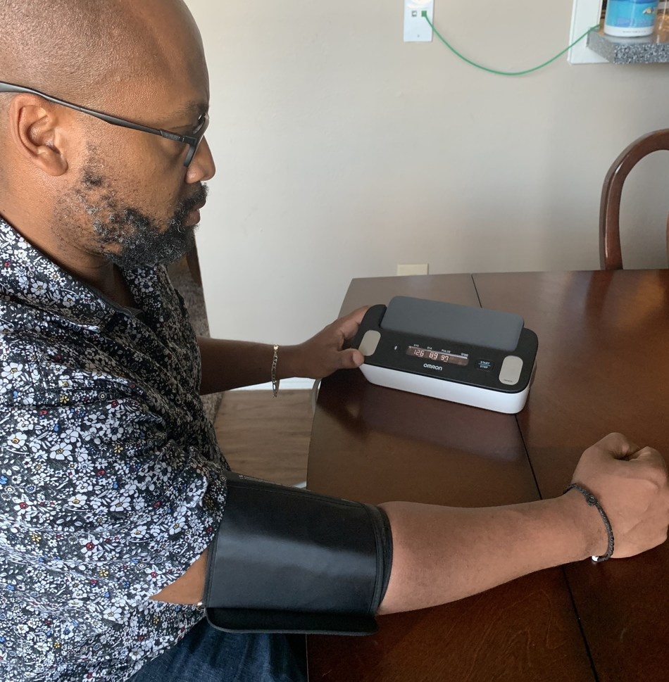 Frederick Goodall, stroke survivor and influencer who writes the Mocha Man Style blog, uses Complete from OMRON to monitor his blood pressure and EKG.