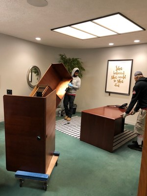 Moving new furniture into the Special Olympics Ohio office