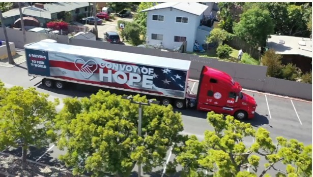 Convoy of Hope trailer with 35,000 lb of food pulls into Venture Church to support food drive.