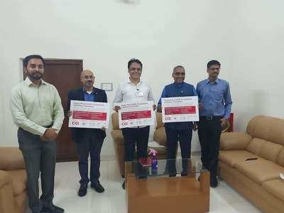 Sudhir Subbaraman, SVP and BU Leader, CGI (Left), and George Mattackal, President, Asia Pacific Global Delivery Centres of Excellence, CGI (Right) hand over PPE kits and equipment to C. N. Ashwath Narayan, Deputy Chief Minister of Karnataka (Center).