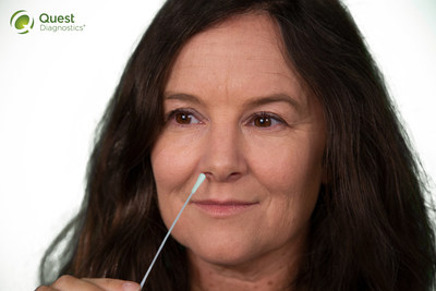 Woman with self collection swab