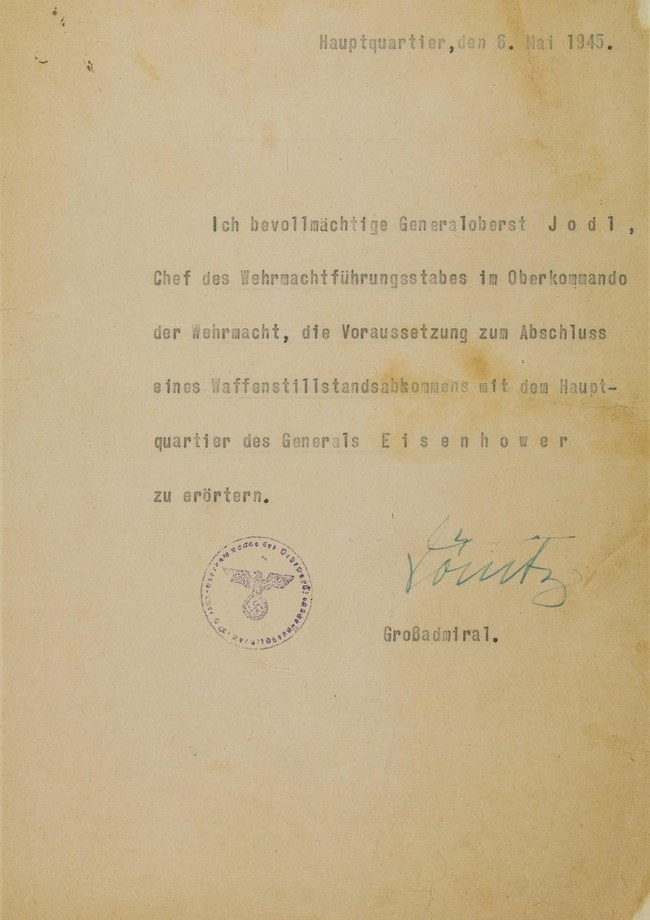 """THE DOCUMENT THAT FORCED THE SURRENDER OF NAZI GERMANY - Letter given to Field Marshal Alfred Jodl. His official credentials allowing him to negotiate Germany's surrender in World War II with the Allies. It is signed by Adm, Karl Donitz, president of Germany following Hitler's suicide. Jodl would sign the surrender the next day, warning Donitz: """"chaos or signature!"""" Valued at $1M, proceeds to be donated to Coronavirus charities worldwide. To be sold by Alexander Historical Auctions, June 9."""