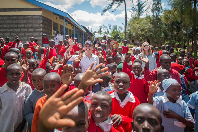 Sarah and Kathryn with a Benefitting Community in Central, Rural Kenya