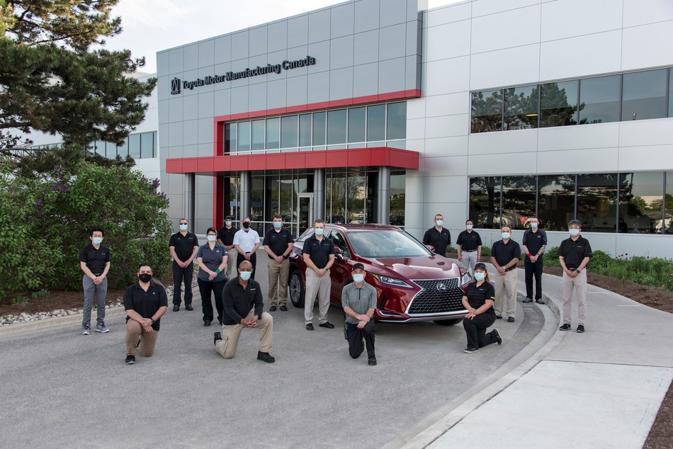 TMMC executives and Team Members pose next to the nine millionth vehicle produced – a 2020 Lexus RX 450h hybrid luxury SUV – in Cambridge, ON, on May 27, 2020. (From left to right) Thomas Asai, Walter Tavares, Steve MacNeil, Trudy Paul, James Lean, Anane Thomas, Dwight Romans, Frank Voss, Derek Kidnie, Colin Crane, Bob Ruggieri, Frank Ricci, Diane Salazar, Ricardo DeSouza, Chad Rose and Kenjiro Okada. (CNW Group/Toyota Canada Inc.)