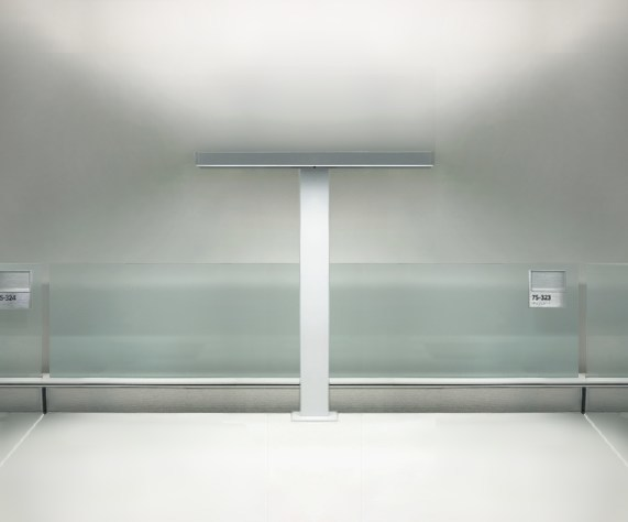 tambient® luminaire on stanchion provides task and ambient light and now also germ-fighting UV-C for work surface disinfection