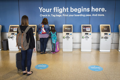"Social distancing decals are located throughout airports to remind flyers to ""Mind Your Wingspan."" The stickers span six feet apart and promote distancing at ticketing counters, baggage drops, customer service centers and gate areas."