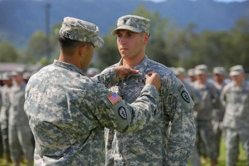 1st Lieutenant Allen Moss is awarded the Air Assault Badge following completion of Air Assault School at Schofield Barracks, HI in 2014.