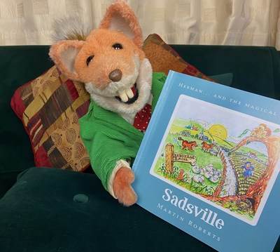 Basil Brush reads Sadsville by Martin Roberts - written in support of the NSPCC and Childline (PRNewsfoto/Martin Roberts Foundation)