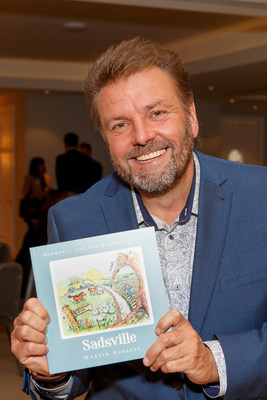 Martin Roberts with his Children's book Sadsville, in support of the NSPCC (PRNewsfoto/Martin Roberts Foundation)