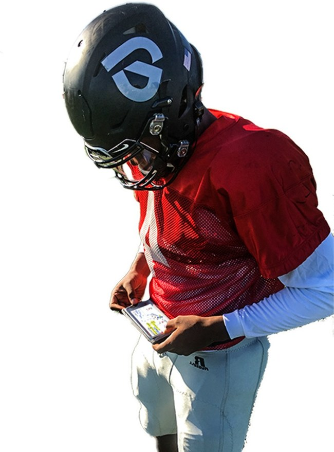 Player is looking at his GoRout device after receiving a play call from a coach.
