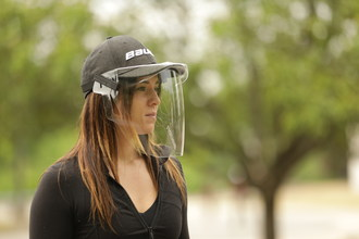 The BAUER Integrated Cap Shield attaches to the brim of a baseball hat or can be worn separately. It is designed to provide protection that stretches from the forehead to chin, offering important eye, nose and mouth splash coverage.