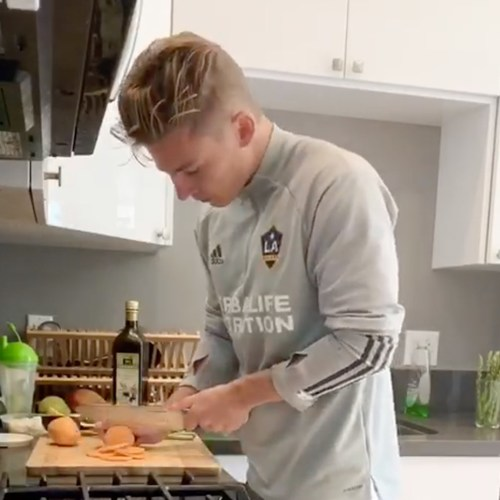"""LA Galaxy's Gordon Wild prepares his winning """"Cozy Salmon"""" recipe from the first global online Herbalife Nutrition #AthleteCookOffContest. The global cooking competition helped encourage healthy eating and the importance of staying active, sparked some competition among company-sponsored athletes and engaged sports fans around the world who longed to watch their favorite sports heroes compete. More photos can be found on the Company's Instagram page https://www.instagram.com/herbalife/"""