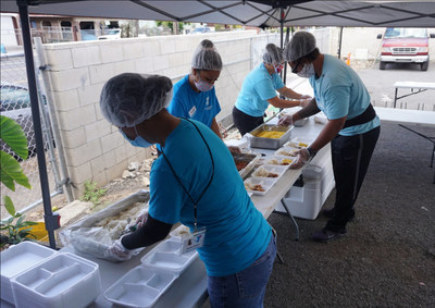 Staff members and volunteers with the YMCA of Honolulu prepare food for the Oahu community.