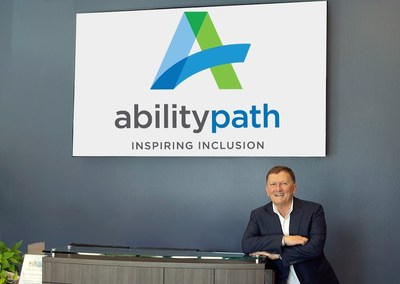 Bryan Neider, CEO of AbilityPath, in the lobby of the AbilityPath headquarters in Redwood City, CA to showcase the new name of the combined nonprofit organizations Gatepath and Abilities United. The two organizations, who serve thousands of individuals with developmental disabilities each day in the greater Bay Area, changed its name to AbilityPath to commemorate its 100 year anniversary founding day, and to position them for the next 100 years.