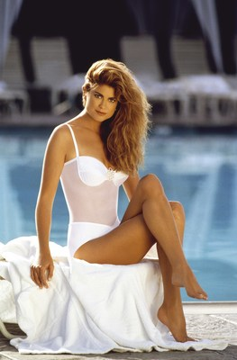 Kathy Ireland, poolside, wearing classic Vintage swimwear on the French Riviera for the Cannes Film Festival at the invitation of Elizabeth Taylor. The image and silhouette are inspirations for design, form, fit and fabrications of kathy ireland Swimwear by Trunkettes, launch.