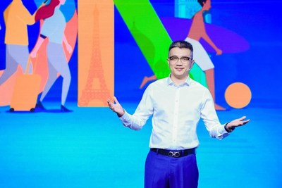"""Trip.com Group CMO Bo Sun (pictured) announces the promotion at the company's """"Travel On"""" launch event."""