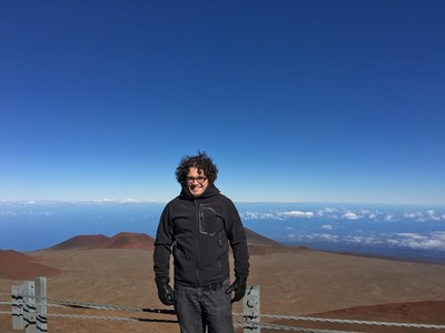 Jonathan Gagné at the summit of Mauna Kea, where astrophysicists have been making observations since 2010 at the NASA's Infrared Telescope Facility (IRTF) to find planets around AU Mic. Credit: Jonathan Gagné. (CNW Group/Espace pour la vie)