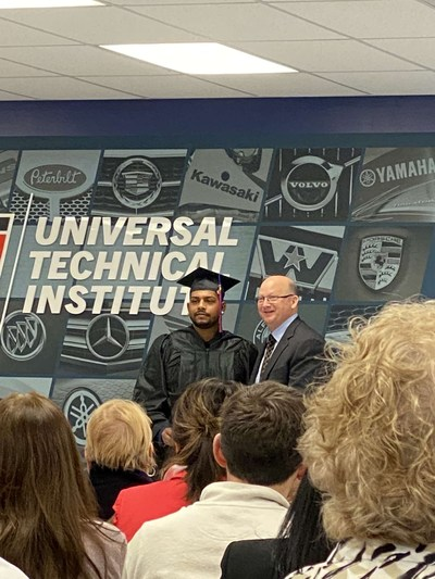 Dylan Bansi, with UTI-Exton Campus President Bob Kessler at his graduation ceremony, now works as a Peterbilt technician and has kept trucks maintained, running and delivering critical goods during the Pandemic.