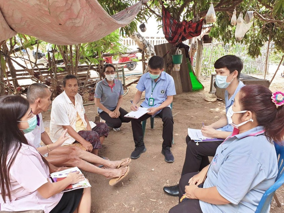 Local health volunteers providing health information to villagers on a personal basis, which is a simple but highly effective preventive measure. (Photo provided by the Ministry of Public Health, Thailand)