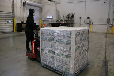 A volunteer at the Greater Chicago Food Depository helps to unload the Minute Rice donation.